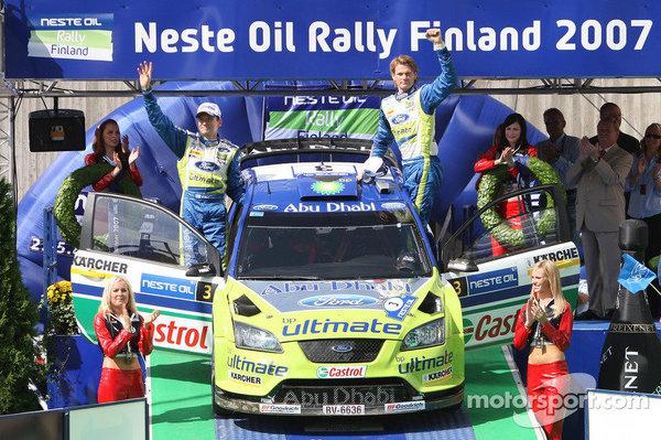 wrc-rally-finland-2007-podium-winners-marcus-gronholm-and-timo-rautiainen-celebrate.thumb.jpg.c04786eabee33300c0f8440de6b1e253.jpg