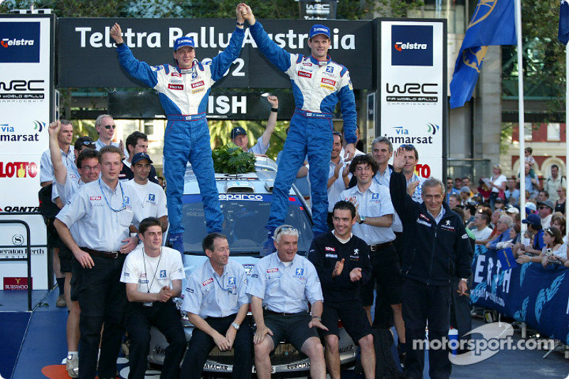 wrc-rally-australia-2002-the-podium-winner-marcus-gronholm-celebrates-with-team-peugeot.jpg.6df2381f9950f2192454b00a921398df.jpg